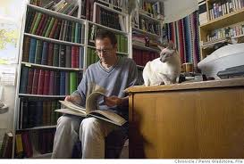 A man, a library, and a cat.  Smells like History to me!